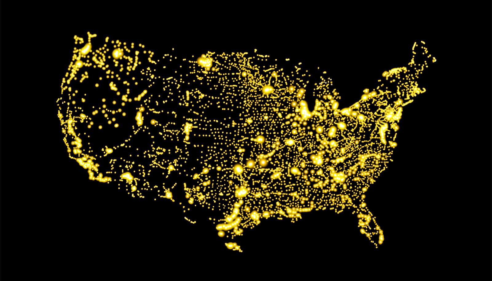 A map of the US in lights against black