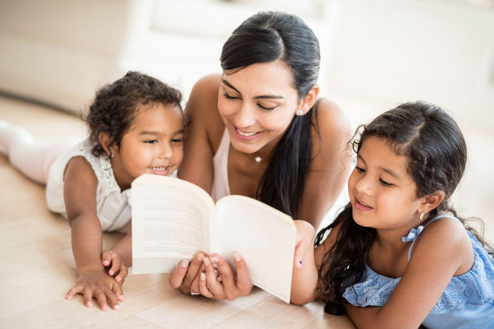 Mom Reading Book to Two Kids