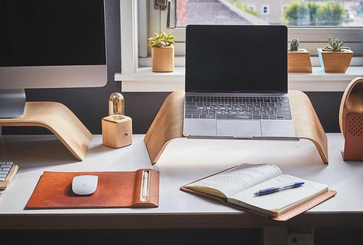 Turning Your Home Into a More Healthy and Productive Space in 2021 by Jori Hamilton. Photograph of a neat desk space by Ken Tomita, courtesy of Pexels