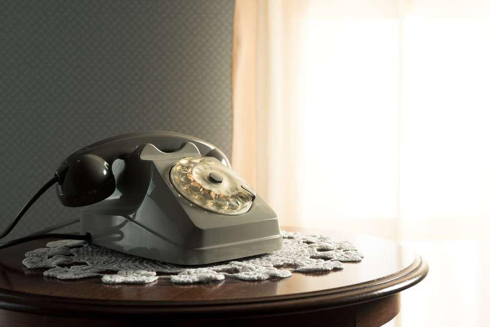 an old fashioned rotary phone on a table