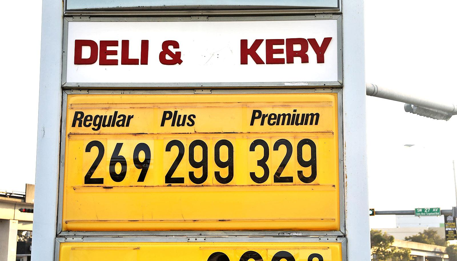 gas prices on yellow sign