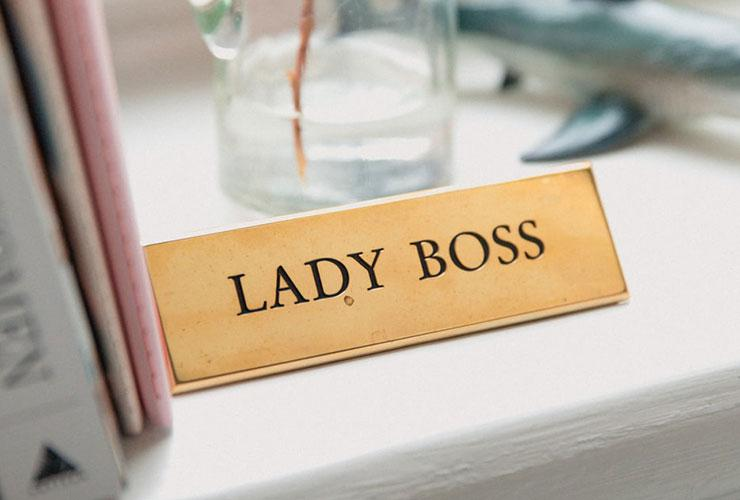 """Overcoming the Challenges of Being a Successful Mother and Businesswoman by Marja Zapusek. Photograph of a metal sign that reads """"Lady Boss"""" by Marten Bjork."""