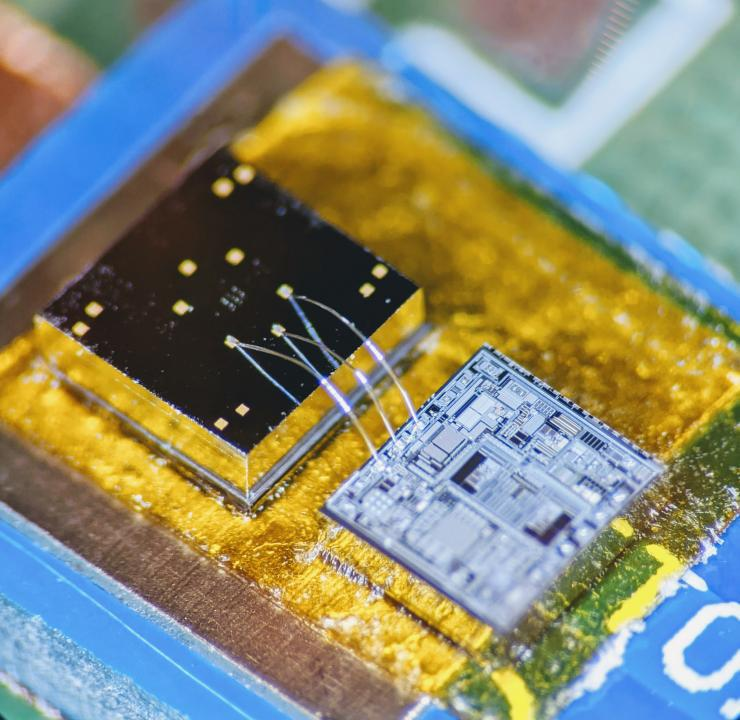 The sensor chip is connected with tiny wires to another chip set in a yellow material