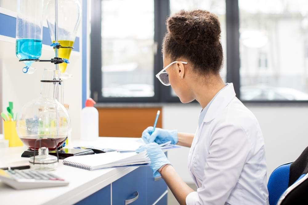 A young female scientist working in a lab
