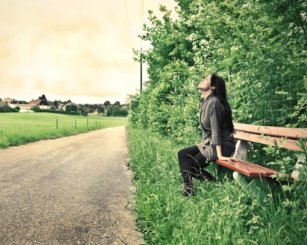 a woman breathing in fresh air
