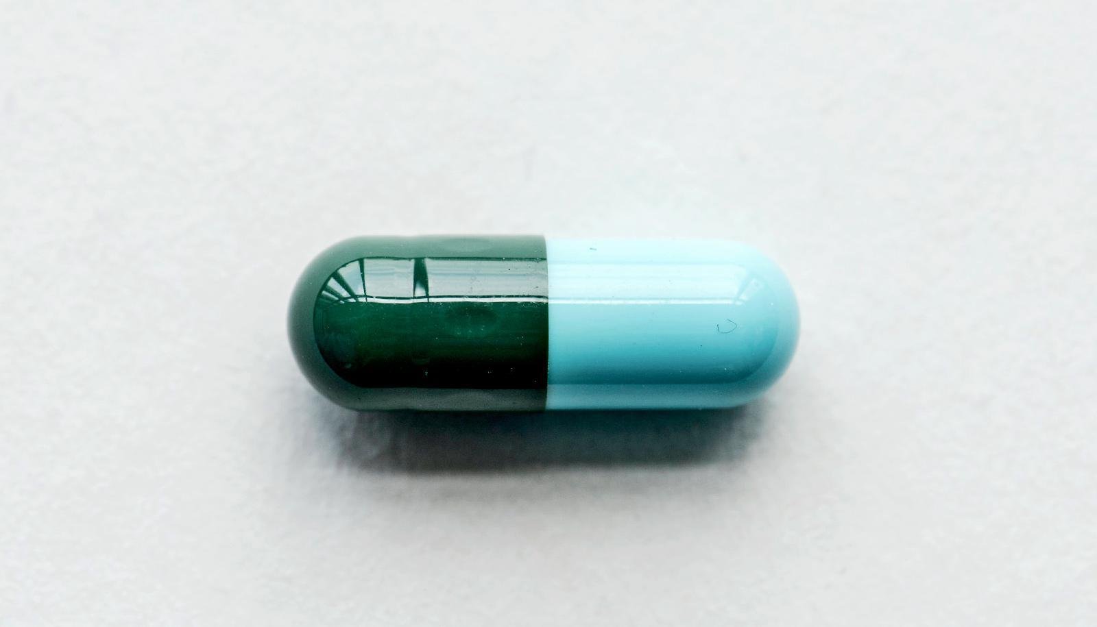 green-blue pill on white - chronic kidney disease