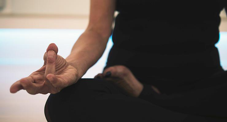 Meditation is Your Best Productivity Tool, by Tom Caklos. Photograph of woman meditating by JD Mason