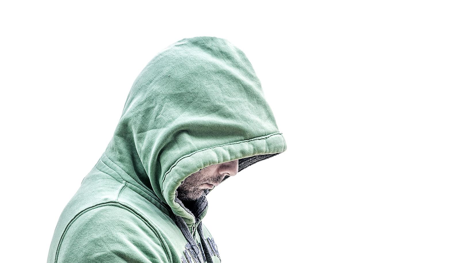hooded man looking down