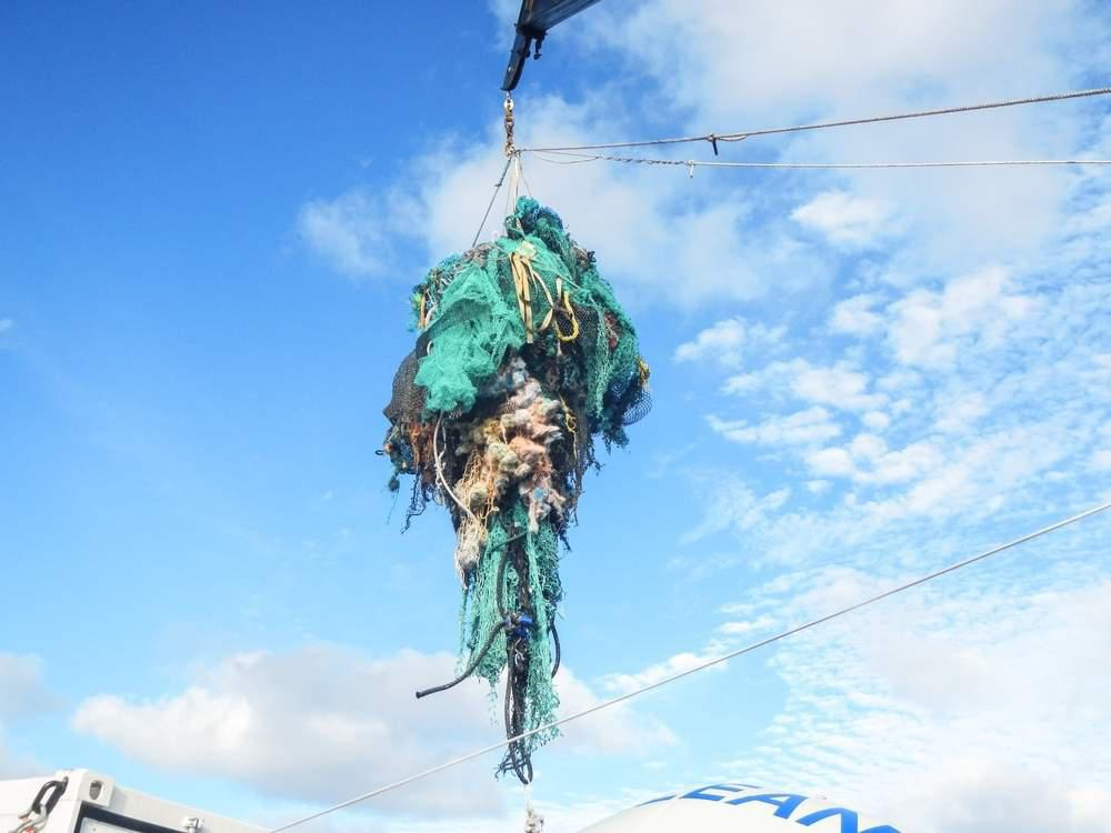 tangled nets suspended on crane