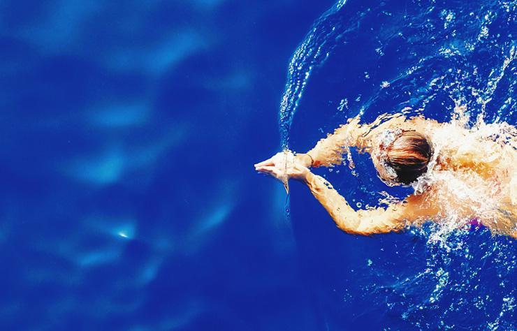 Swimming for Strength, Injury Recovery, Positivity and Overall Health, by Jane Sandwood. Photograph of swimmer by Efe Kurnaz