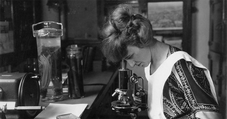 woman with microscope vintage