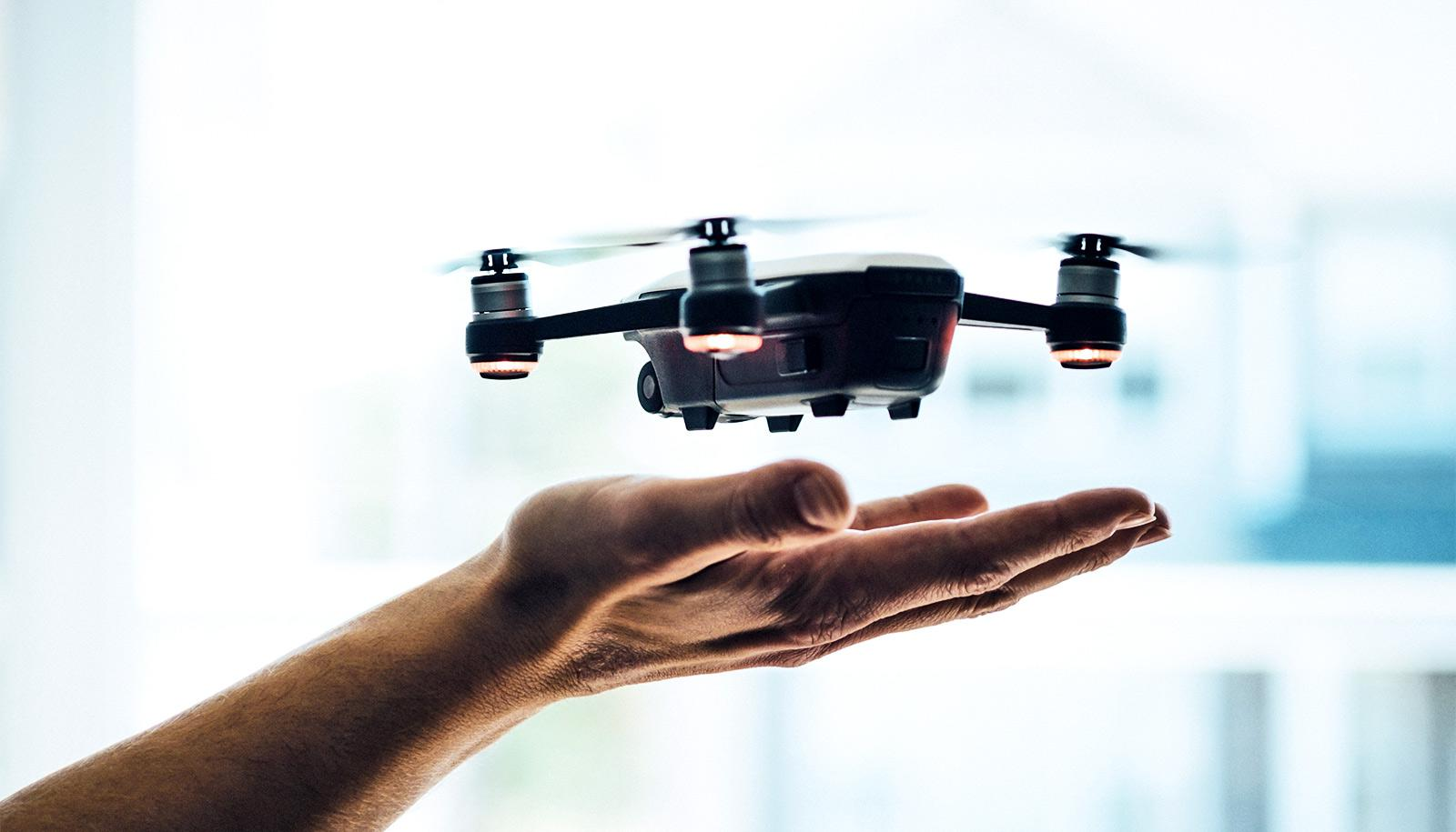 drone hovering over hands