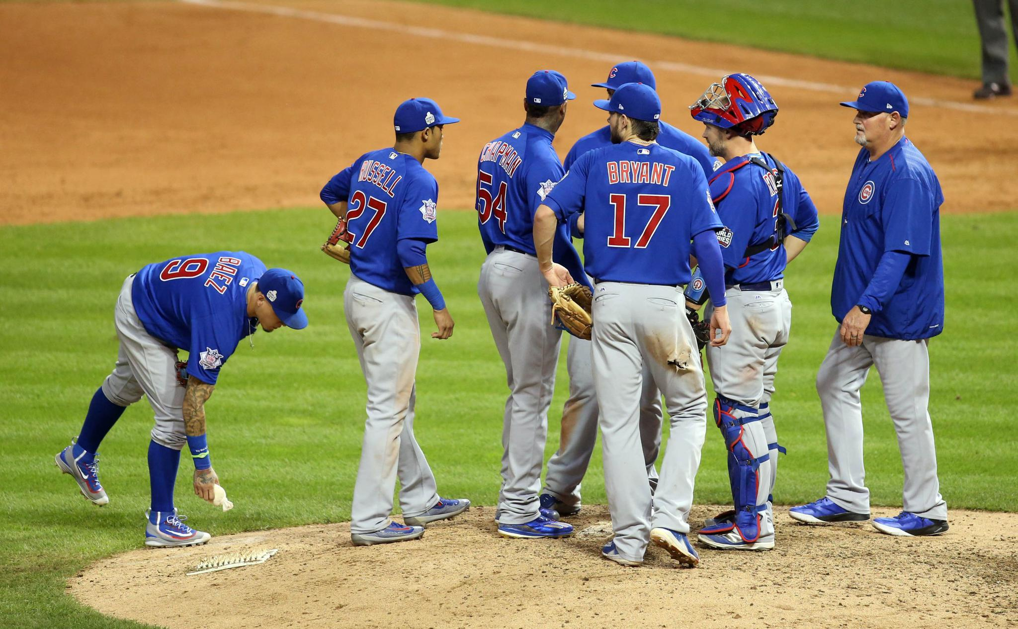 Mound meetings like this one are a factor in the pace of play.