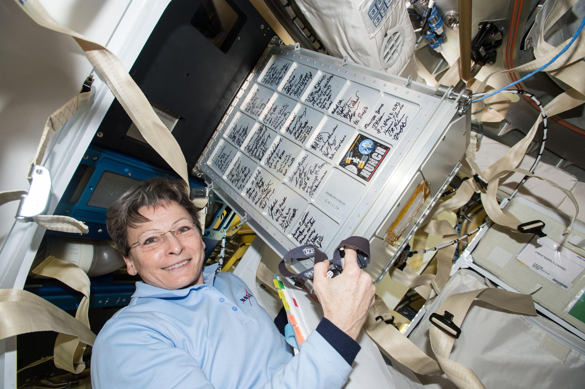 NASA astronaut Peggy Whitson unloads a storage locker that was built as part of the NASA High School Students United with NASA to Create Hardware (HUNCH) program, on the International Space Station on March 9. Students in the HUNCH program receive valuable experience creating goods for NASA, from hardware to meals for astronauts, while NASA receives the creativity of the high school students.