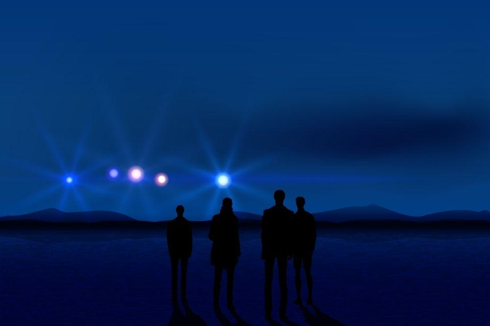 People look out into a night sky dotted with unidentified flying objects.