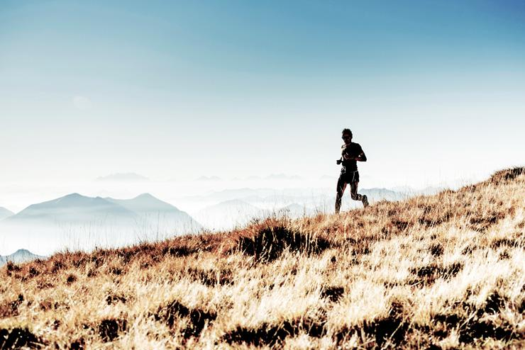 Tips to Make Your Workout Eco-Friendly, by Ian Lewis. Photograph of runner outdoors by Asoggetti