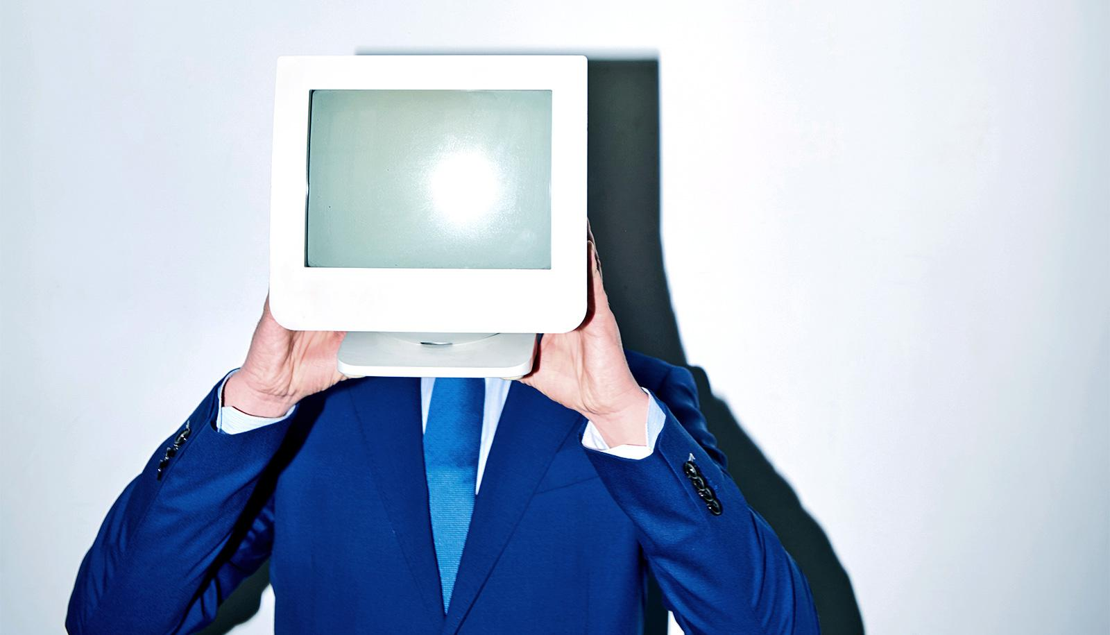 man holding monitor in front of face (artificial intelligence concept)