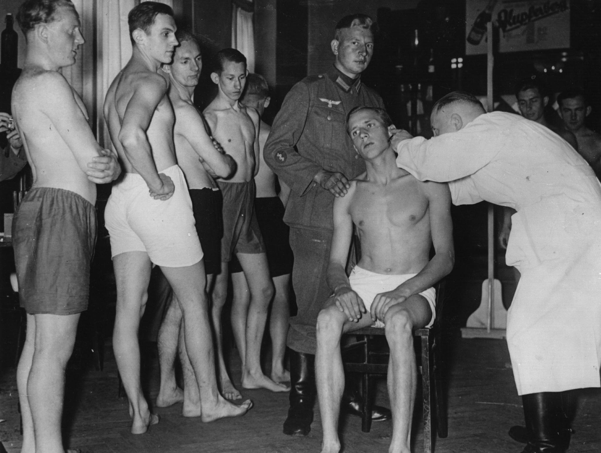 Young conscripted recruits undergo a medical examination in Berlin, Germany on June 22, 1937.