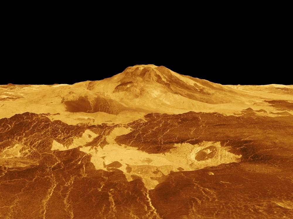 yellow mountains and surface of planet against black background