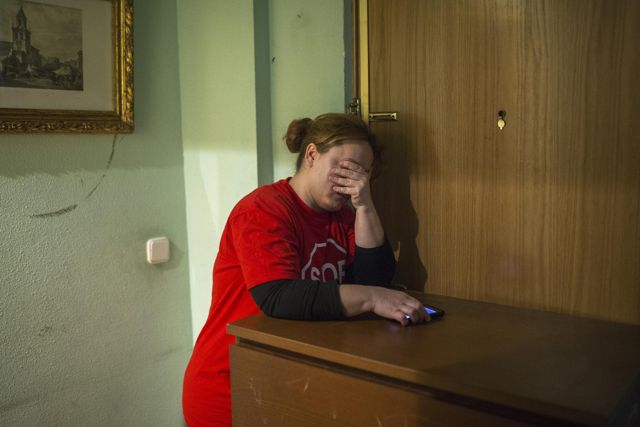 Rosario Echevarria Pedrezuela, 35, tries to stop police from entering the apartment she has occupied for the last ten months with her husband and their two children after they were evicted from their previous home in Madrid on Feb. 16, 2015.