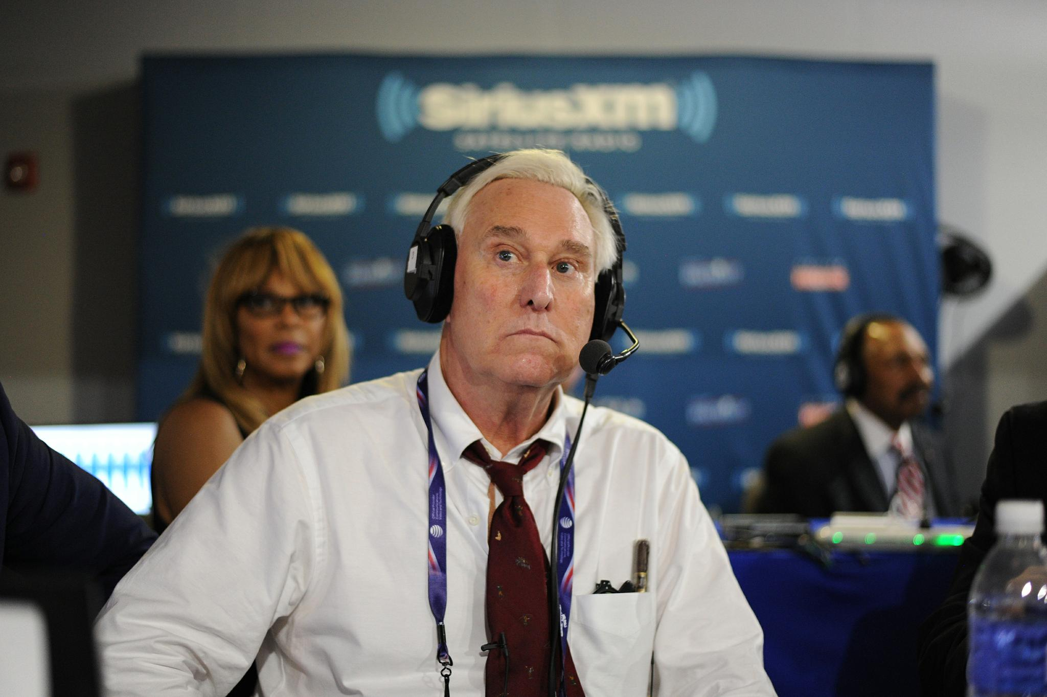 """Former Donald Trump adviser Roger Stone listens to host Jonathan Alter talk during an episode of """"Alter Family Politics"""" on SiriusXM at Quicken Loans Arena on July 20 in Cleveland."""