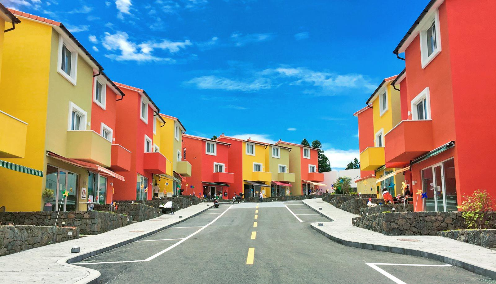 red and yellow buildings in neighborhood