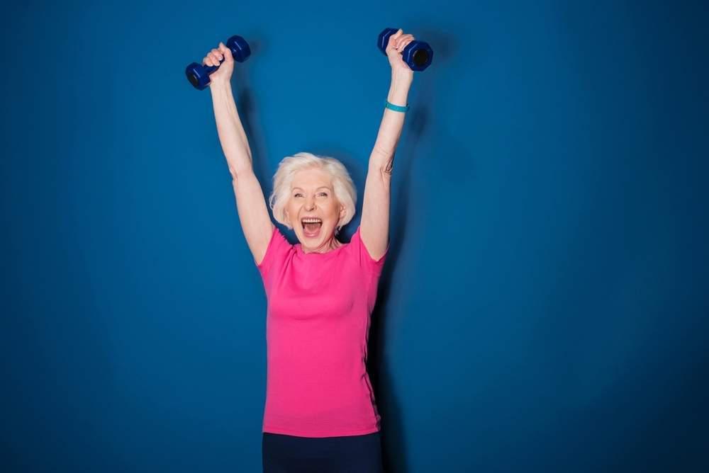 elderly woman excited weights