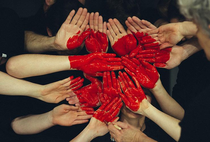 10 Longevity Tips All Women Need to Know for a Healthy Heart by Lynda Arbon. Photograph of a group of hands together with a heart painted on them by Tim Marshall