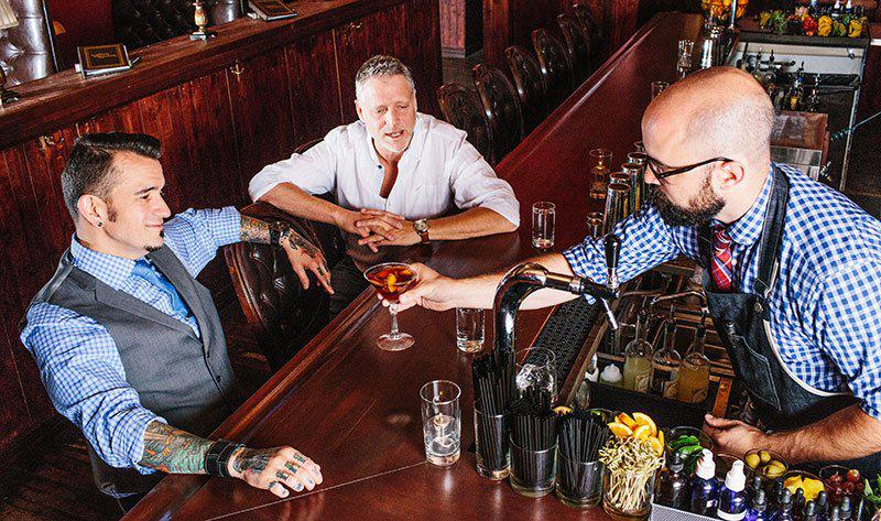 A tall drink: Sean Kenyon with co-founder Todd Colehour (center) and bartender Chad Michael George.