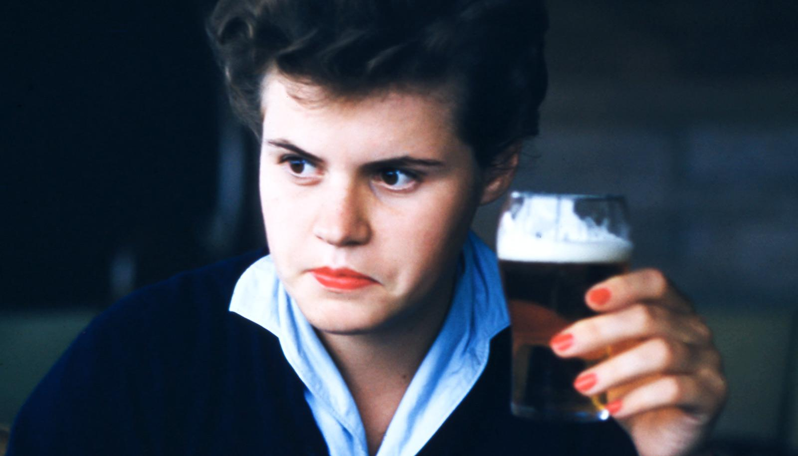 1950's person holding beer stares intensely