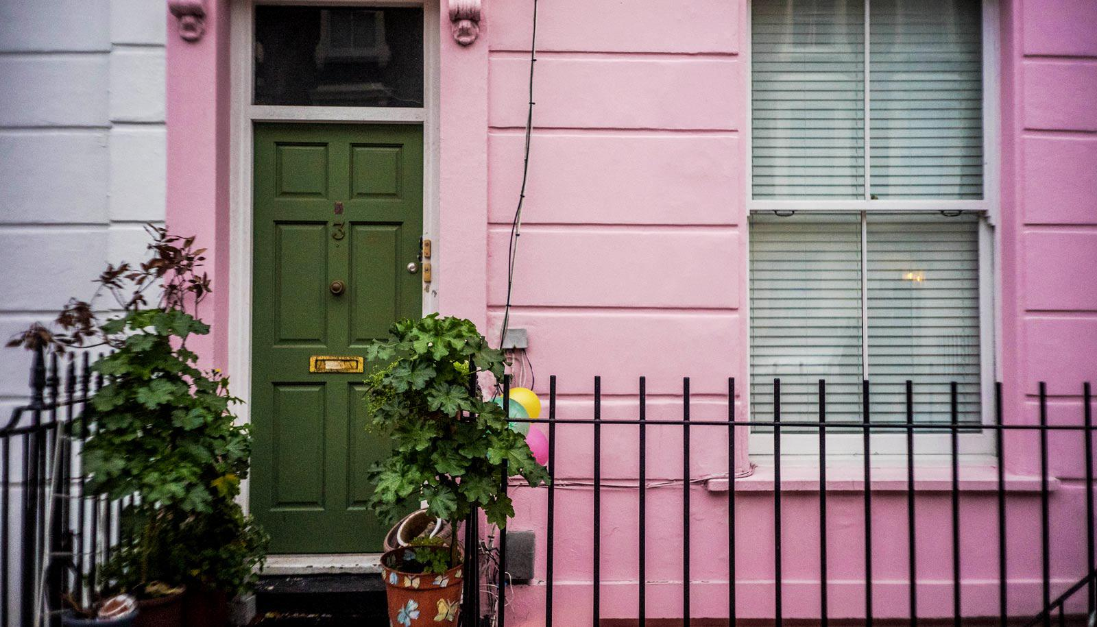 pink house with green door