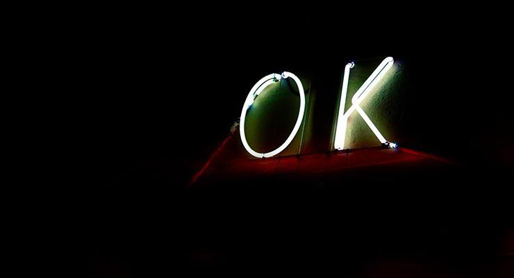 I'm OK: What Does That Really Mean For You? By Judy Marano. Photograph of neon OK sign by Jeremy Perkins.