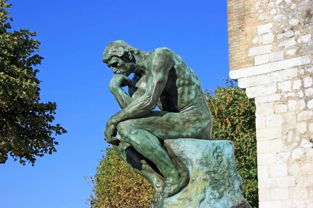 a statue of a man thinking