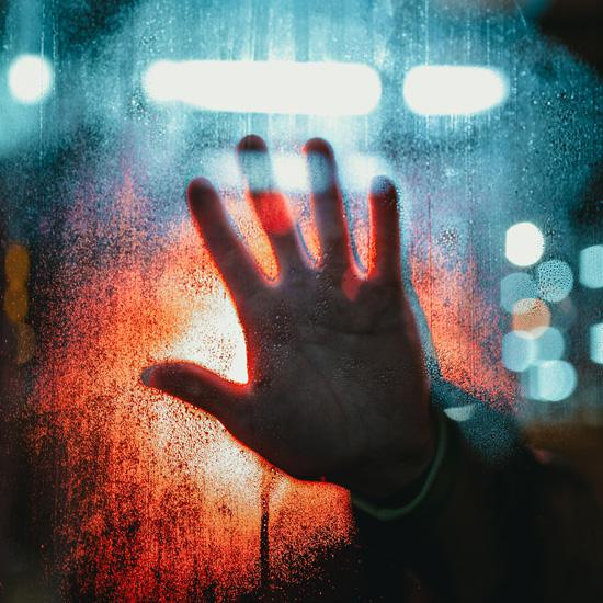 The Virus of Fear: How to Cope with Fear in Times of Uncertainty, by Sara Fabian. Photograph of hand against window by Josh Hild