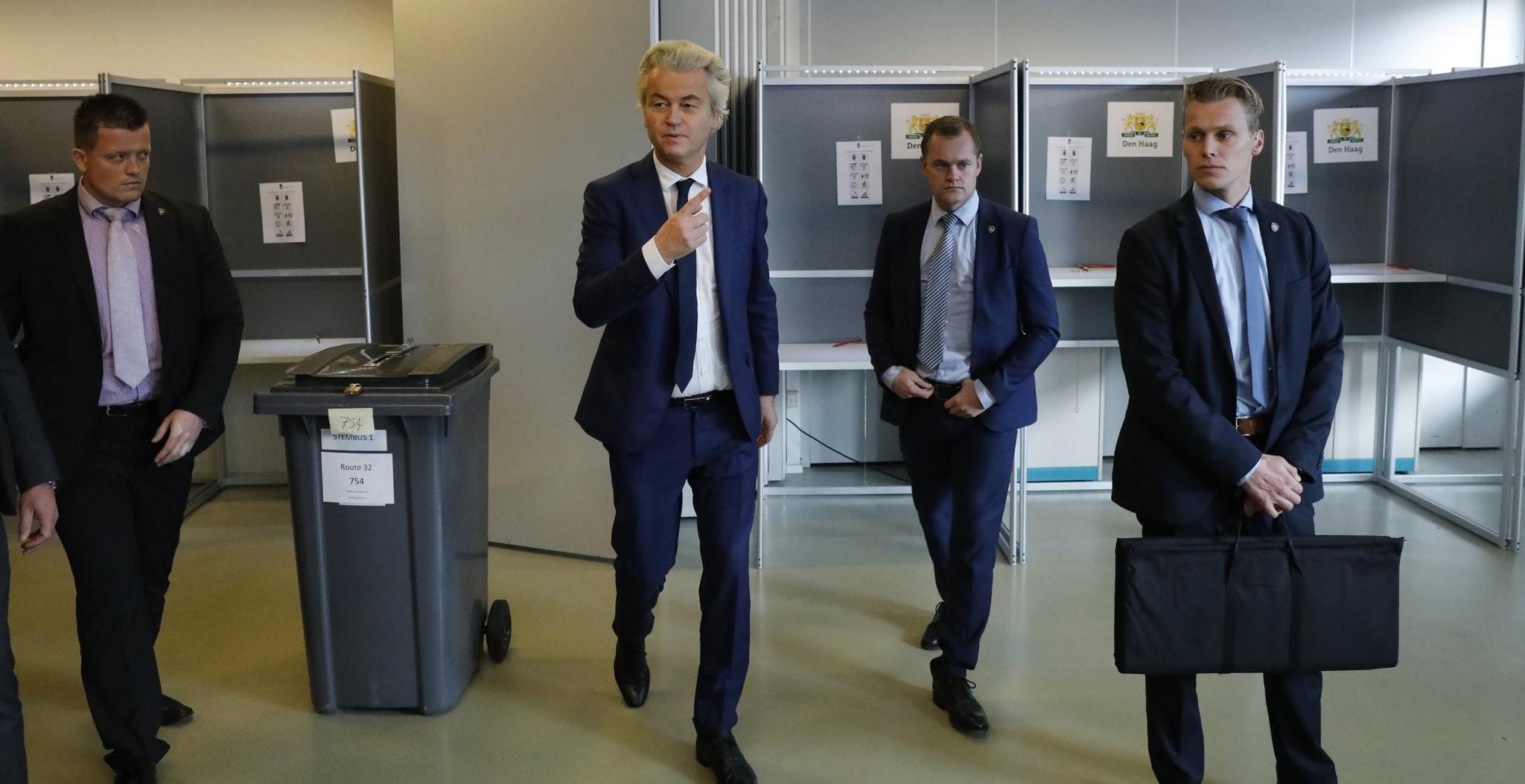 Dutch far-right politician Geert Wilders of the PVV party is surrounded by security as he votes in the general election in The Hague, Netherlands, on March 15.