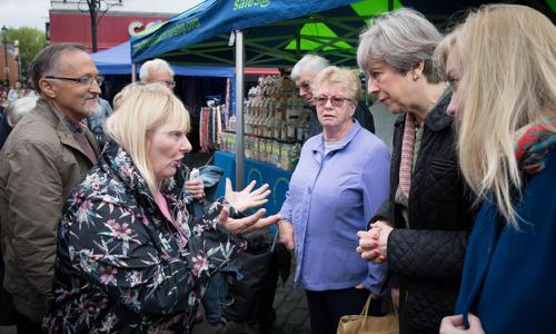 Theresa May meeting voters , during the 2017 general election campaign.