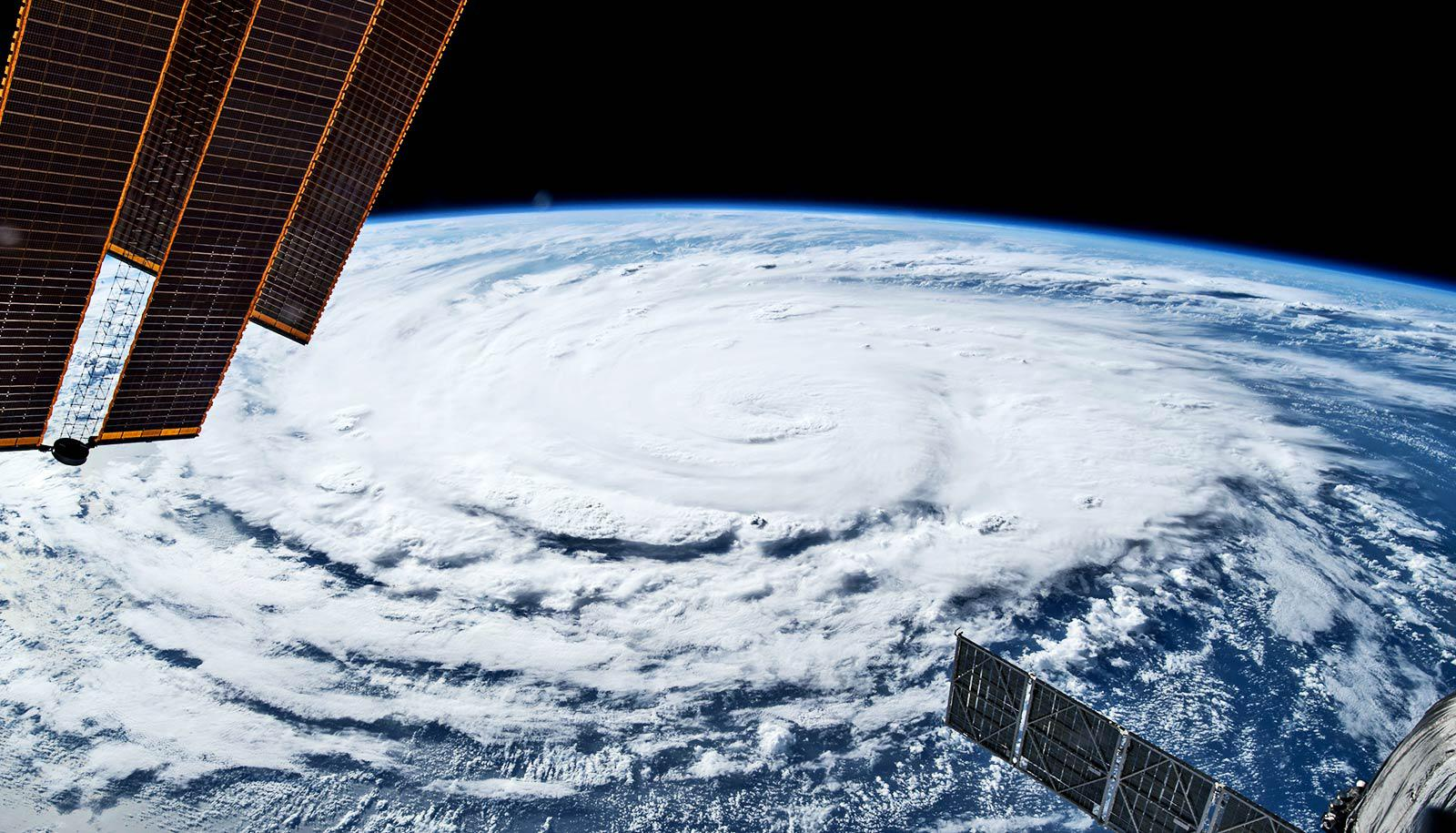 A hurricane swirls on Earth's surface as seen from space